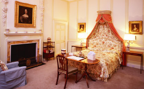 Bedroom with portrait of Queen Mary